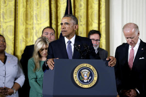 President Barack Obama, joined by Vice President Joe Biden and gun violence victims, speaks earlier today in the East Room of the White House about steps his administration is taking to reduce gun violence. Also on stage are stakeholders, and individuals whose lives have been impacted by the gun violence. CAROLYN KASTER / AP