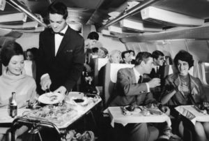 Cabin service on board an intercontinental Boeing 707 during a flight with the West German airline Lufthansa, 26th April 1967. (Photo by Fox Photos/Hulton Archive/Getty Images)
